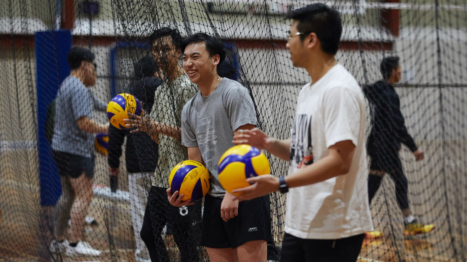 Two male Volleyball players about to start playing