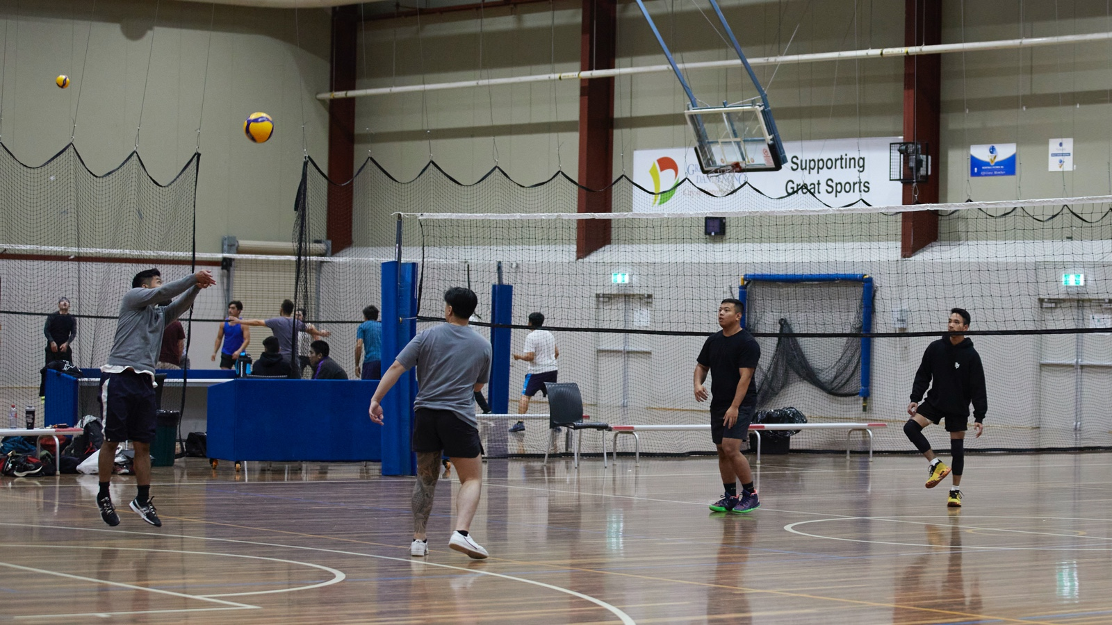 Group of male Volleyball players playing indoors