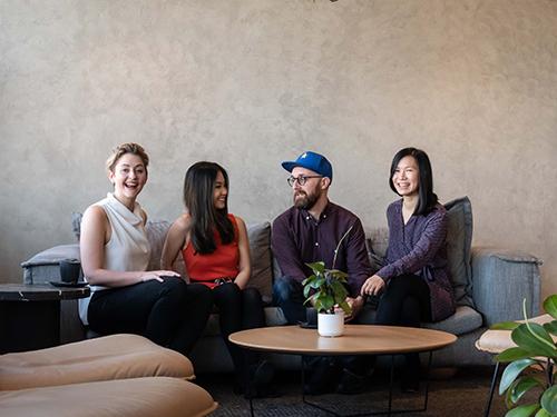 Team photo of Sarah, Rachel, Simon and Becky sitting on a couch