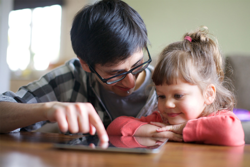 Father reading to her daughter