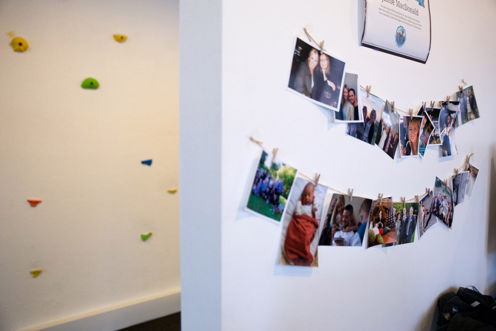 Photo collage hanging on a white wall