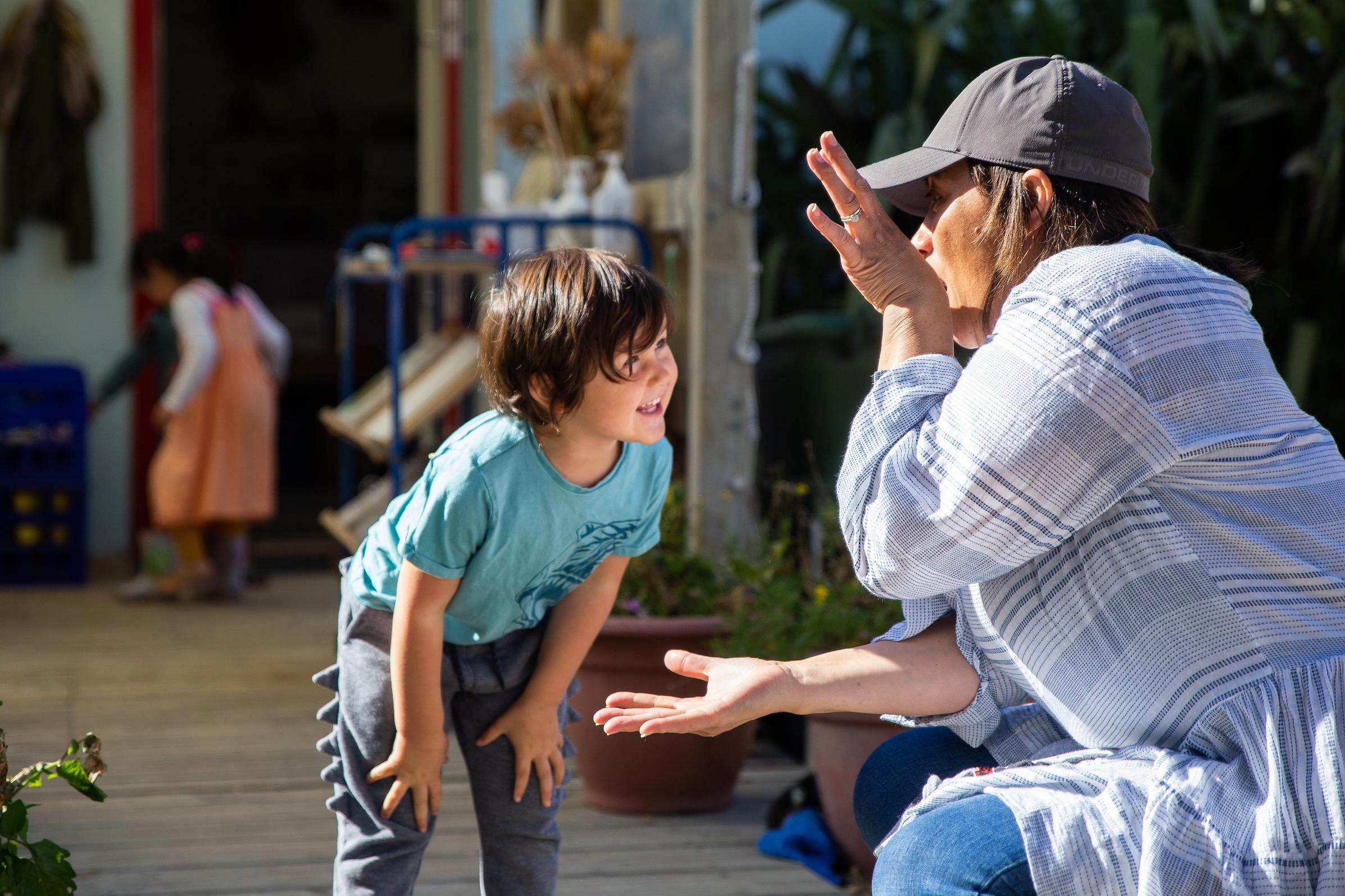 Preschool teacher playing with a  toddler