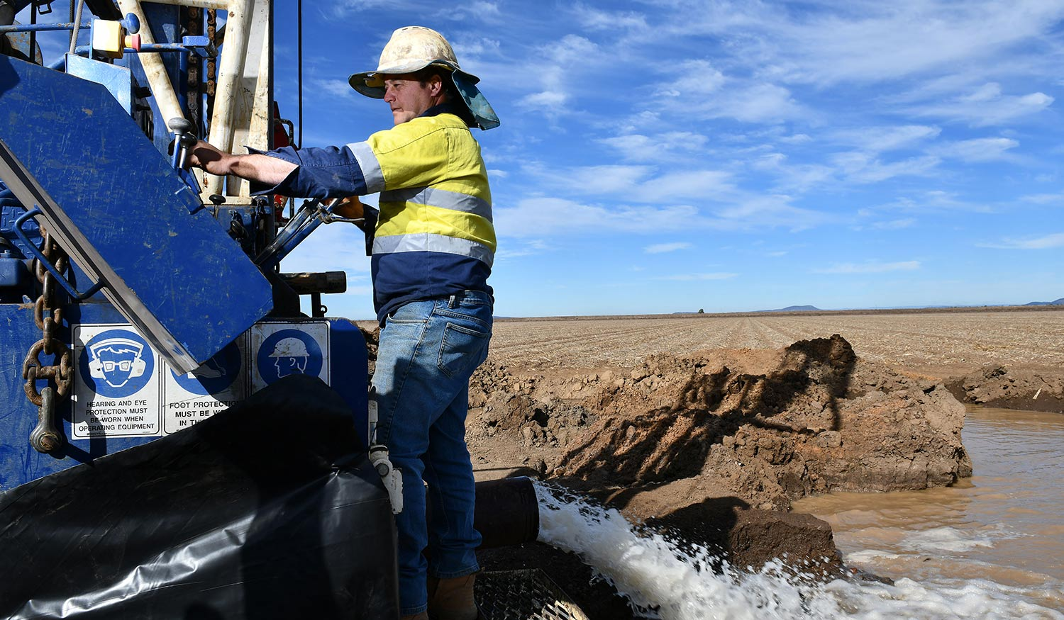 A man operating a water drilling
