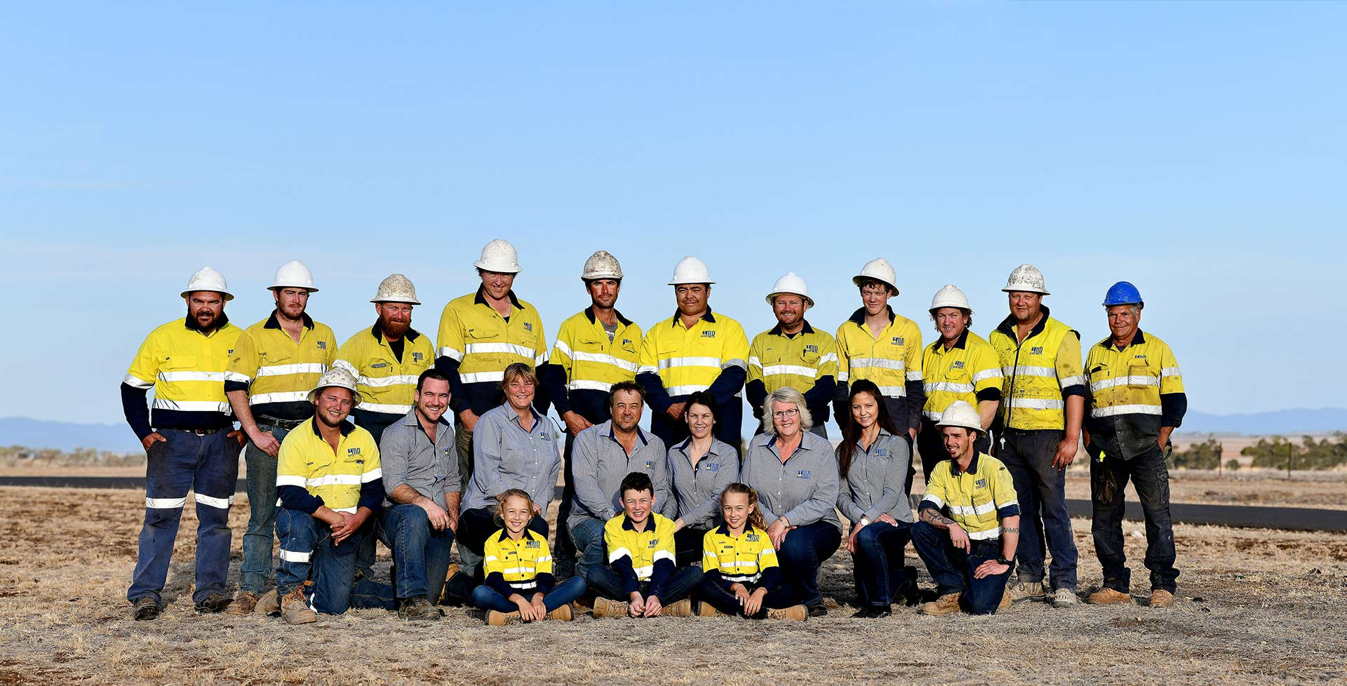 Employees of Mannion drilling wearing their yellow uniform