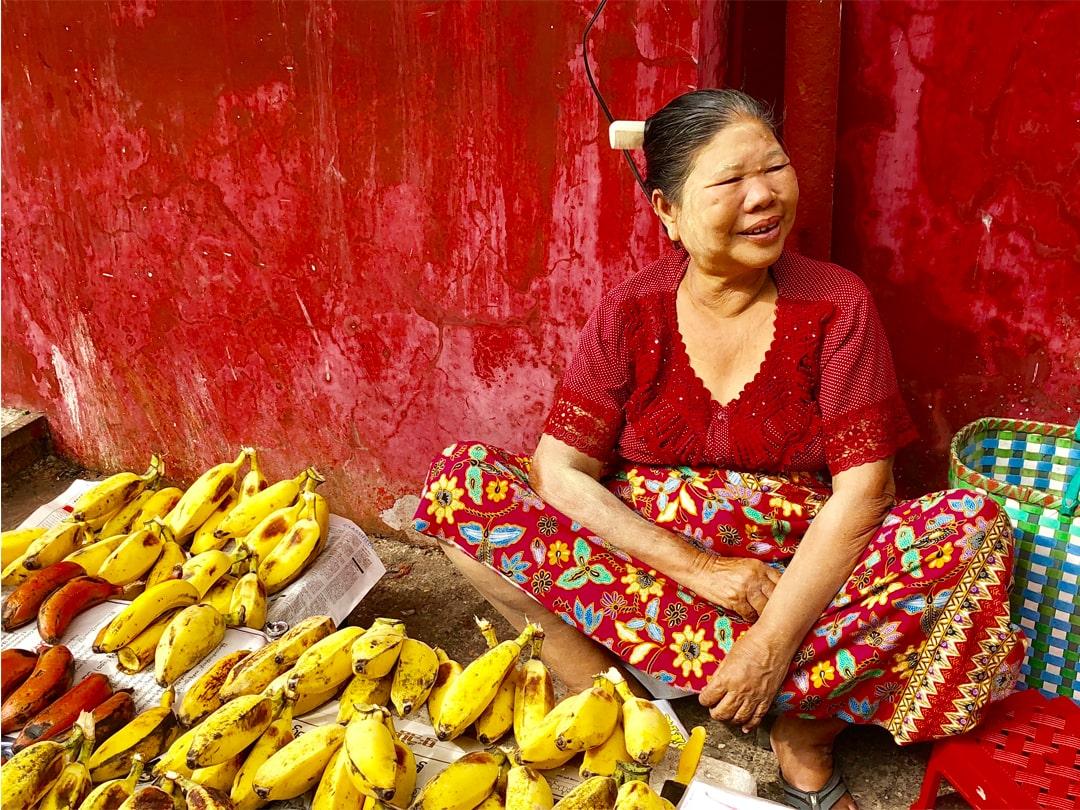 Woman selling fruit in open market.