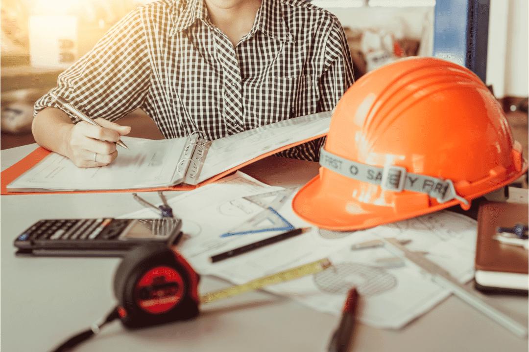 plumber planning measuring desk hard hat tape calculator pen binder work station
