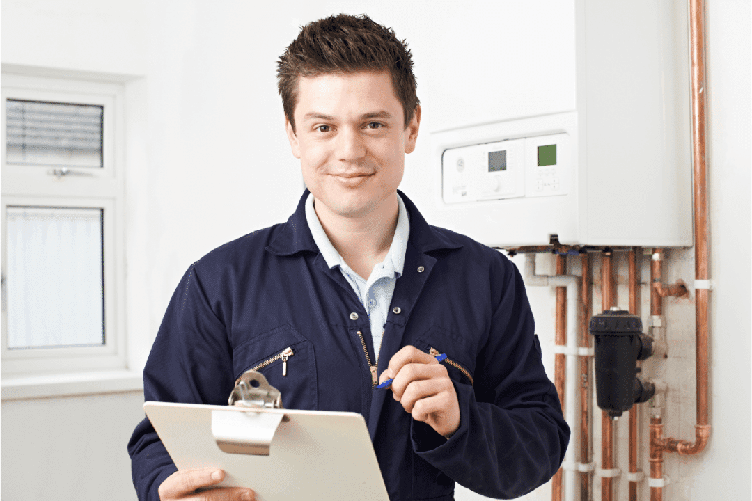 plumber with clipboard giving quote total cost of services boiler