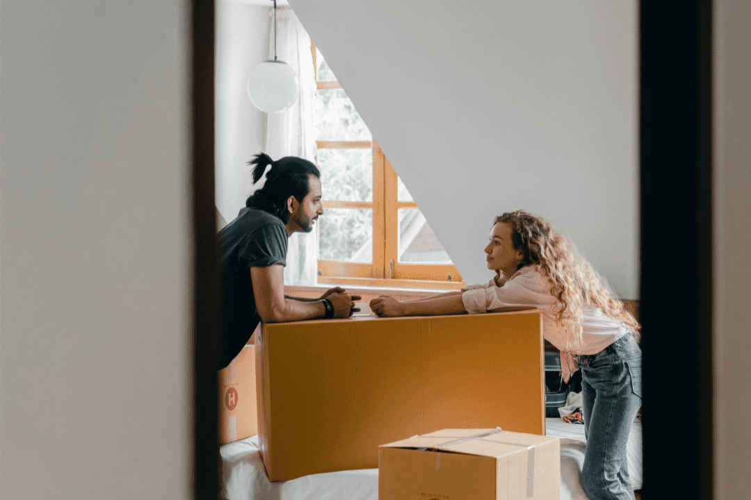 young couple recently moved in unpacking boxes