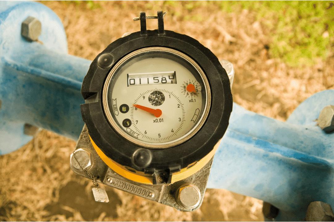water meter in yard black circle with readings