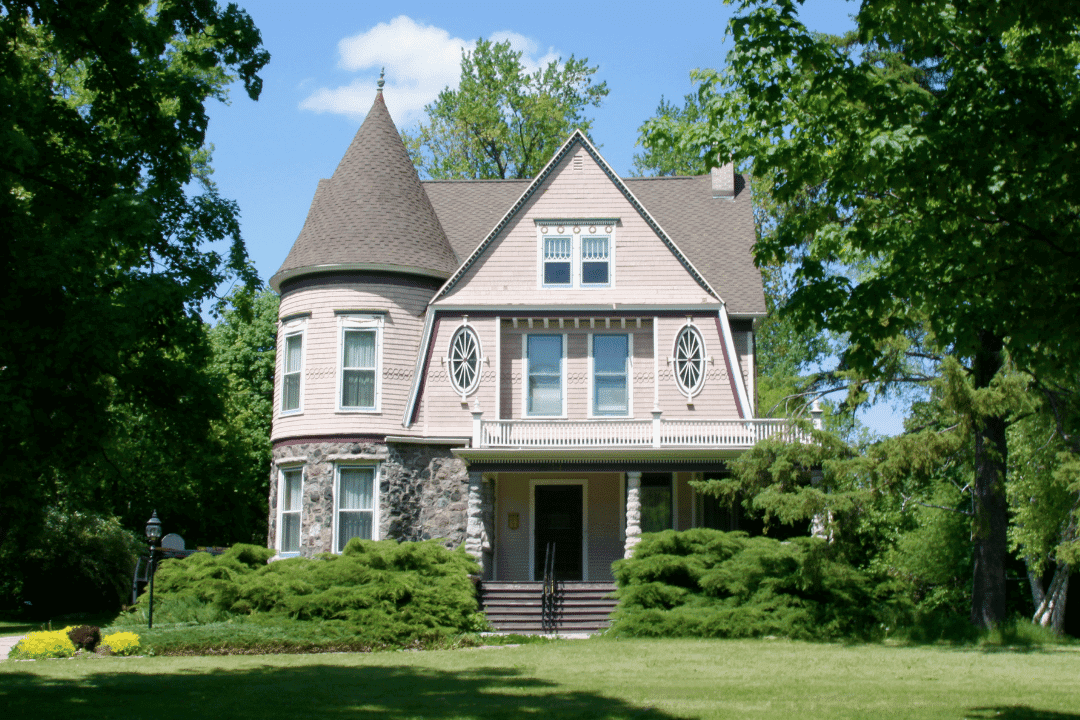 old victorian home in wooded area summer