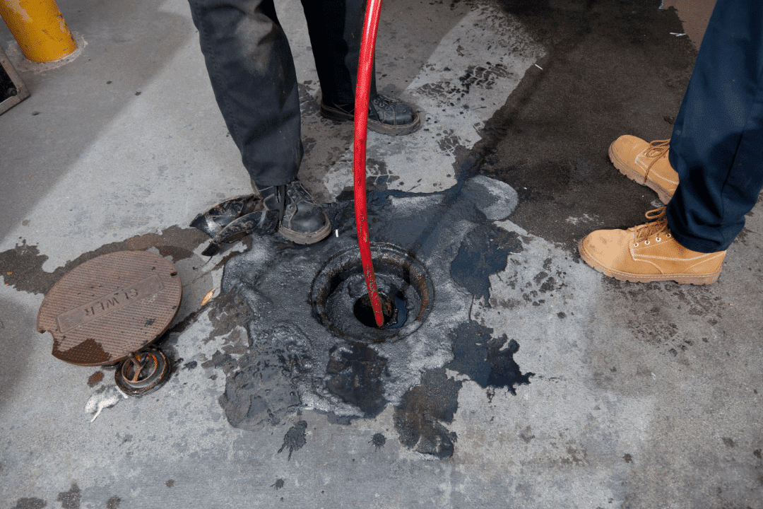 sewer line camera being used work boots