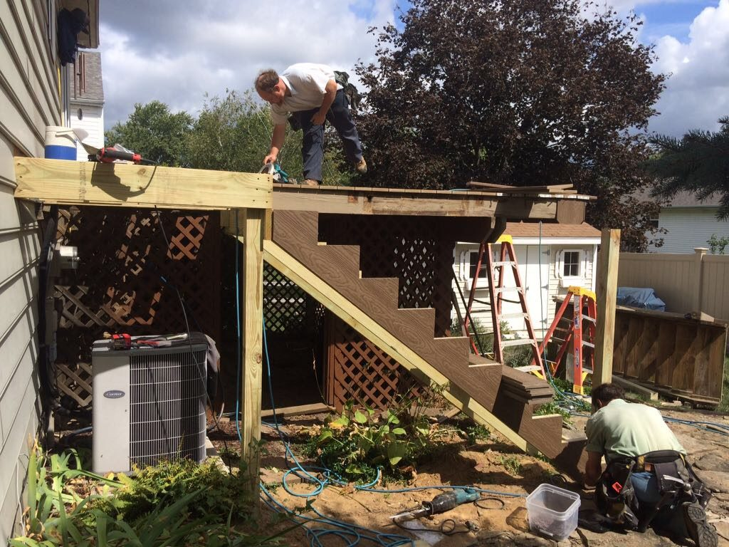 our amish crews installing a deck