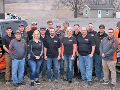 A group picture of 16 KLINE employees