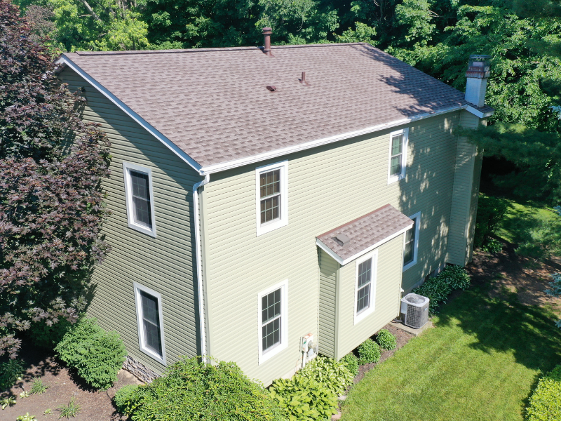 We completed an entire makeover on this home in Akron, Ohio. Mr. Pera hired us first to change his siding, add stone, change his roof and gutters. After working with us and being thoroughly impressed with the workmanship of our Amish crews Mr. Pera then hired us to replace windows and replace his wood deck with a low maintenance composite deck.