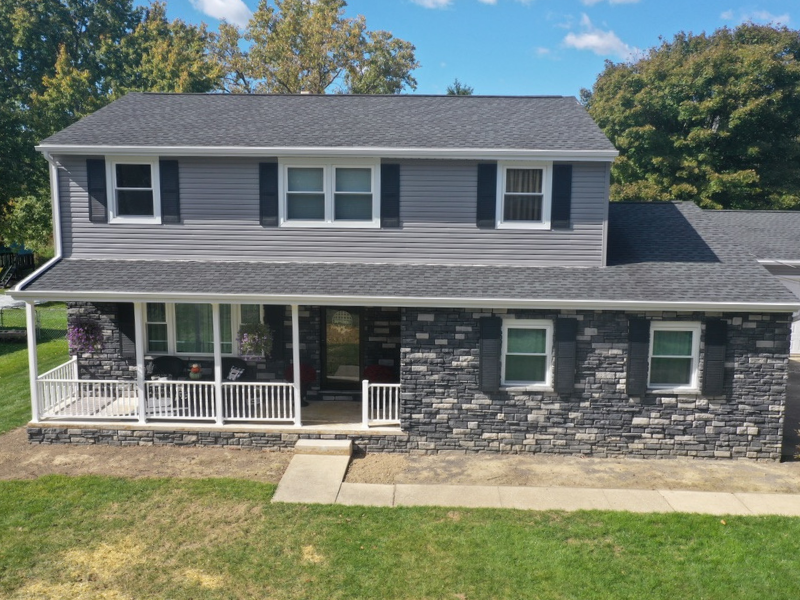 We were able to update vinyl siding, add stone, replace doors and windows on this home in Smithville, Ohio. We love the way the colors of the vinyl siding and stone complement each other perfectly to create an attractive look.