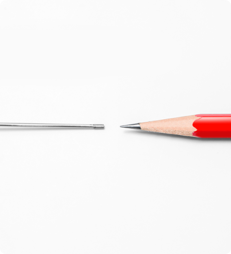 IntraVu scope next to a red pencil tip. Illustrates a size comparison between the pencil tip and the small size of the micro arthroscopy or needle arthroscopy scope