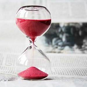 Photo of a red hourglass counting down dental insurance benefits 2017
