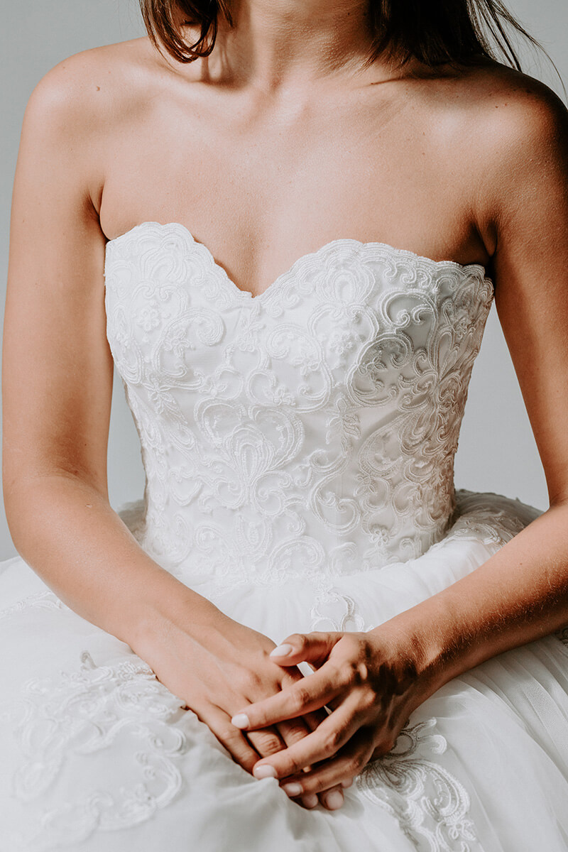 Torso view of a woman in her wedding dress