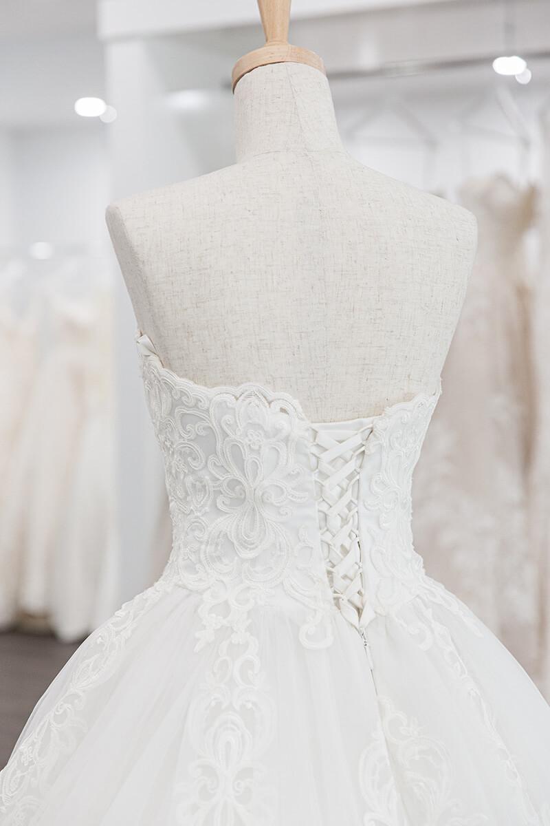mannequin wearing a white wedding dress