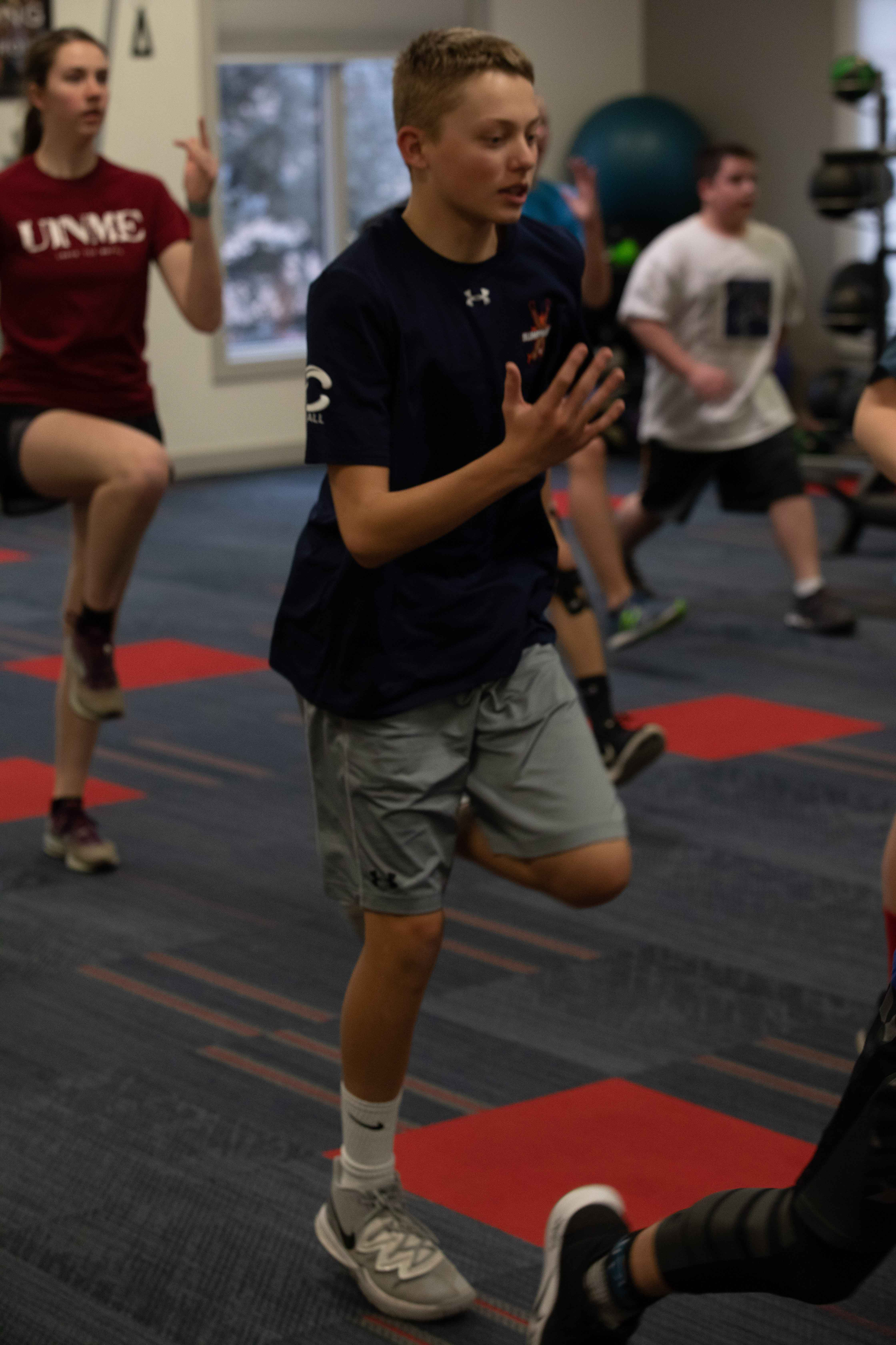 Image of young people doing a run-in-place warmup exercise