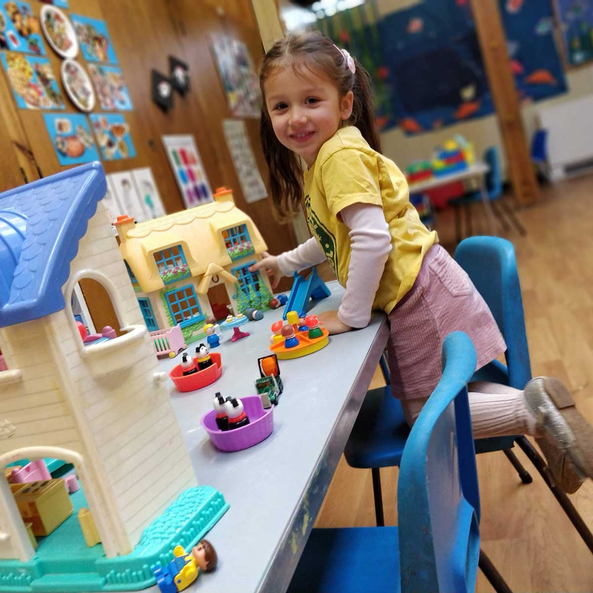 A young girl playing happily at Whiteway Pre School