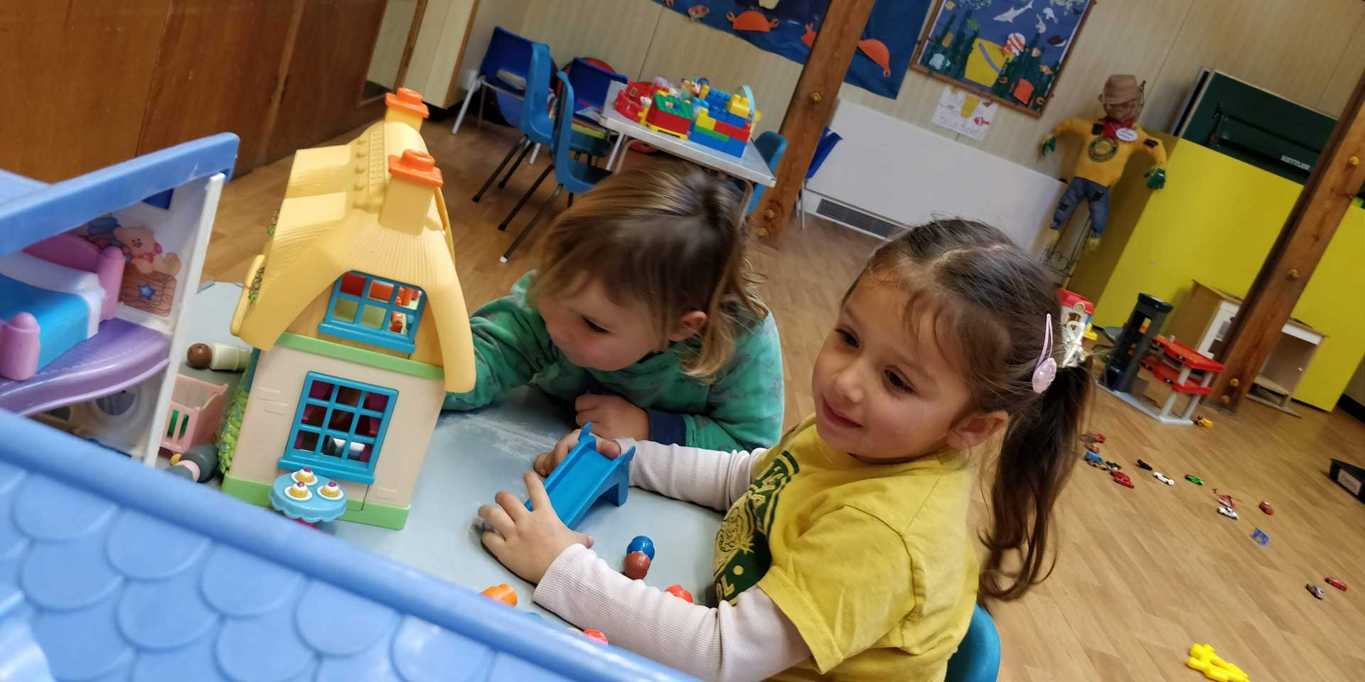 A girl and a boy playing together at a table at Rottingdean Whiteway Pre-School