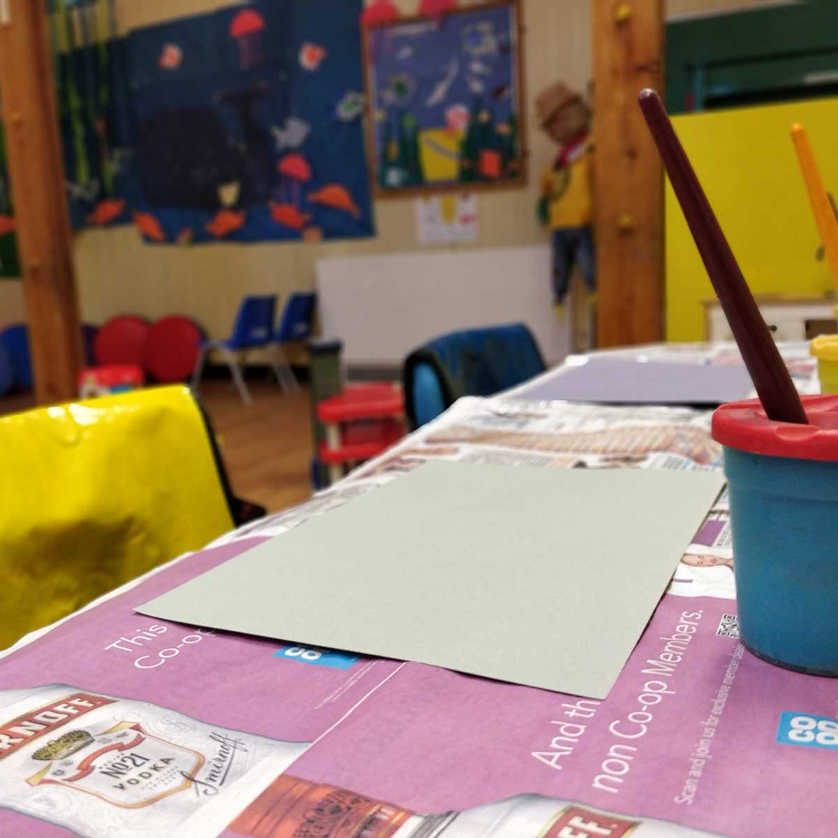 Painting items on a table at Rottingdean Whiteway Pre-School