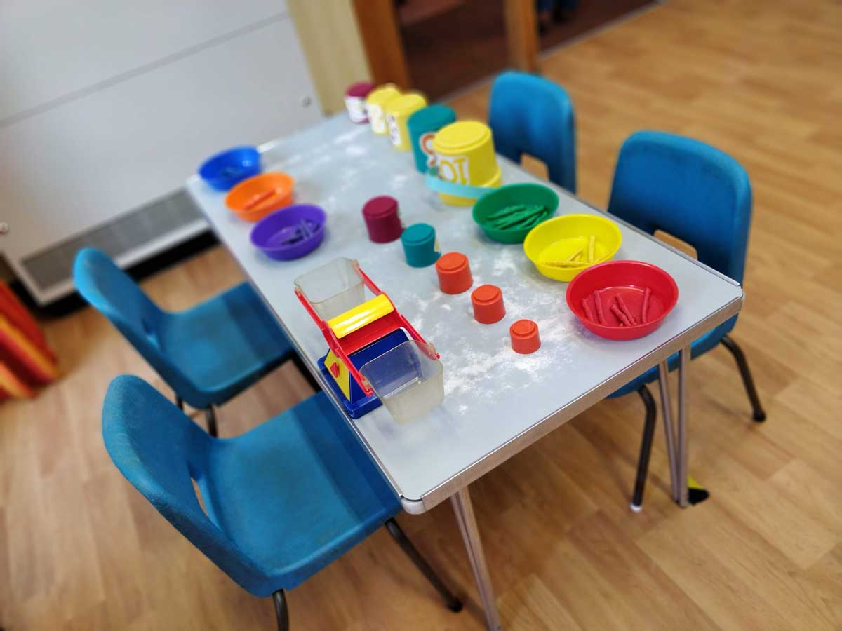 A table set out with paints and pots at Rottingdean Whiteway Nursery