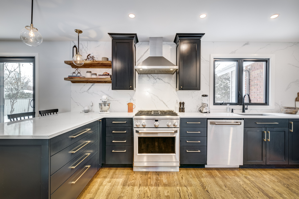 When it comes to choosing between refacing your kitchen or renovation there's a lot to take into consideration including budget and design. Learn more!