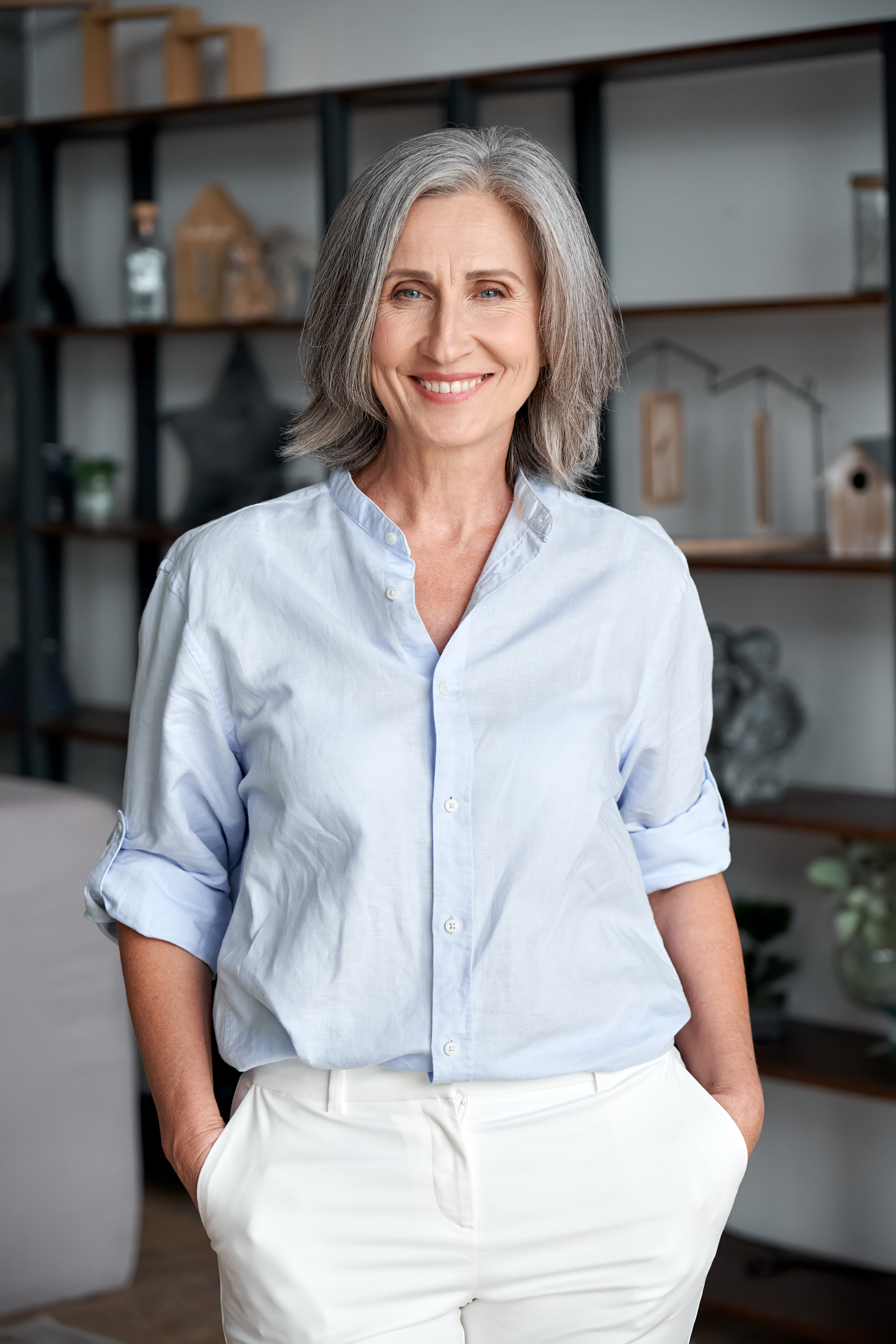 Mature woman standing and smiling in her office