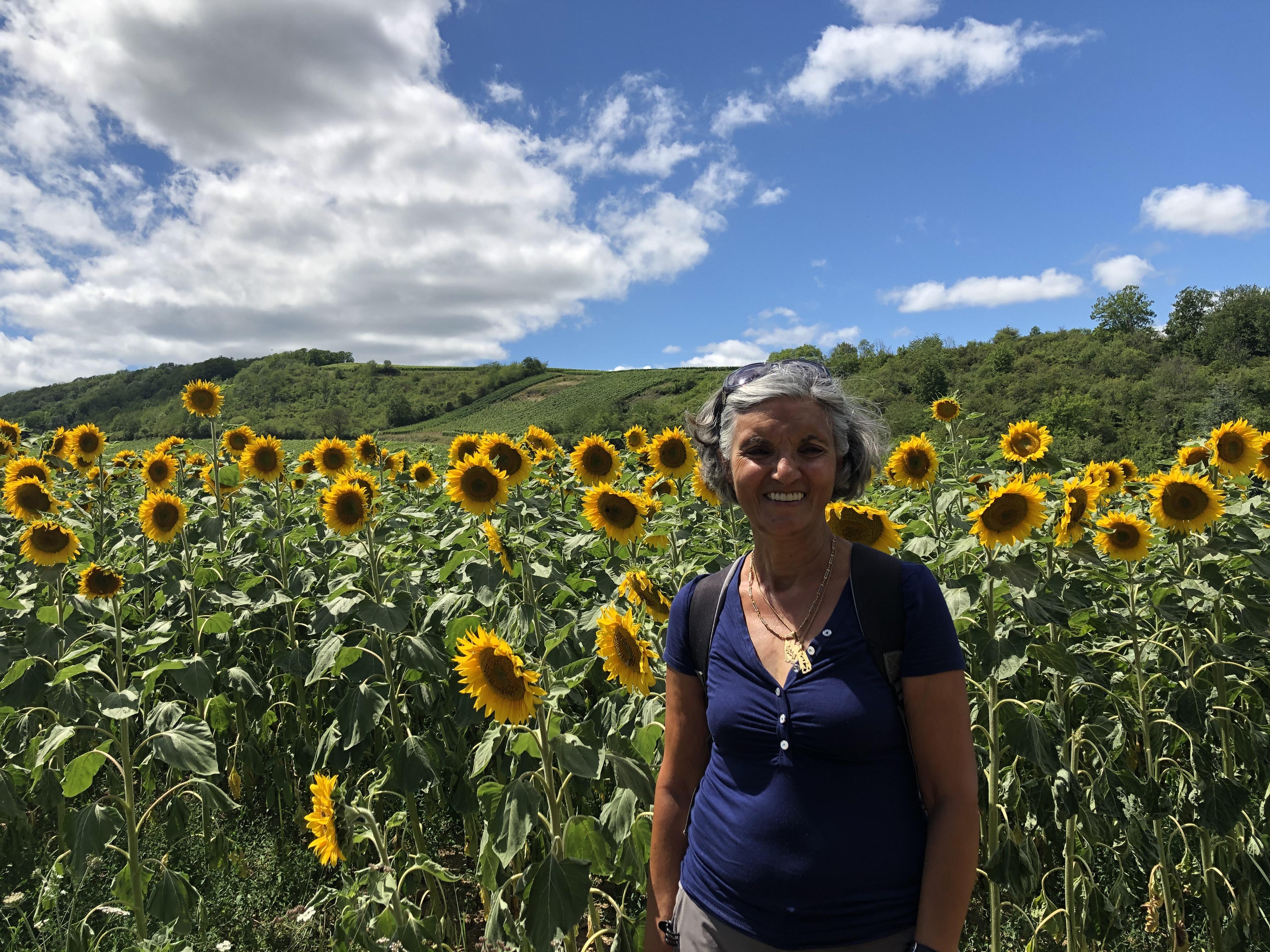 Monique Bienmuller standing in nature.
