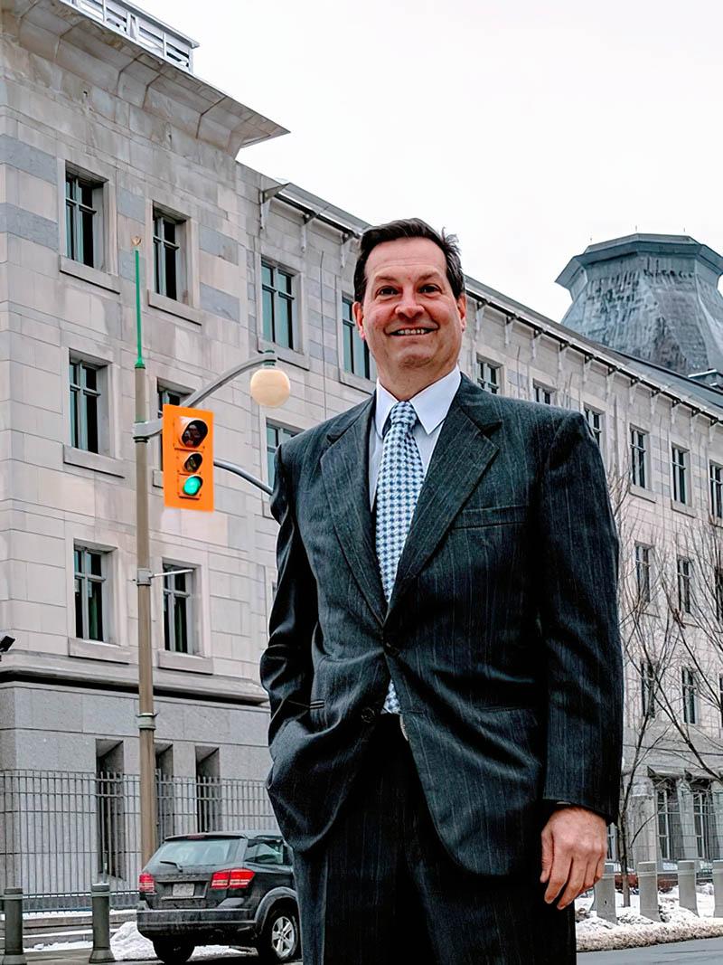 Photo of Rolf Baumann outside Ottawa building