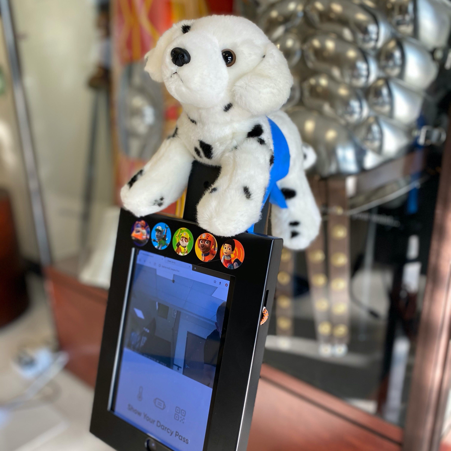 cute stuffed animal mounted on the kiosk keeps the experience friendly for the little ones