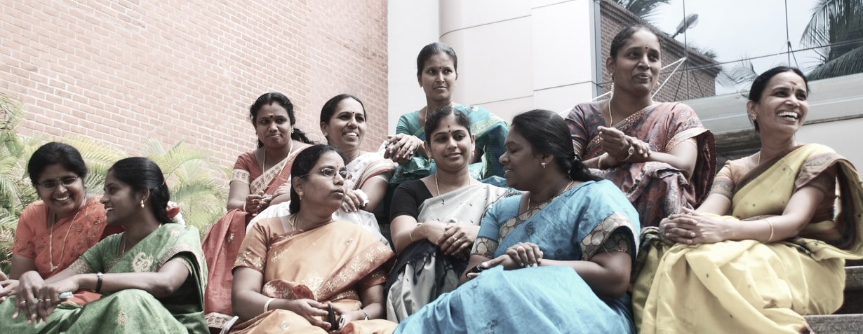 Diamond building wit  empowered Indian women in front