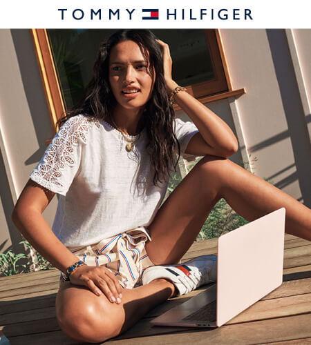 Young woman wearing Tommy Hilfiger shorts and white t-shirt
