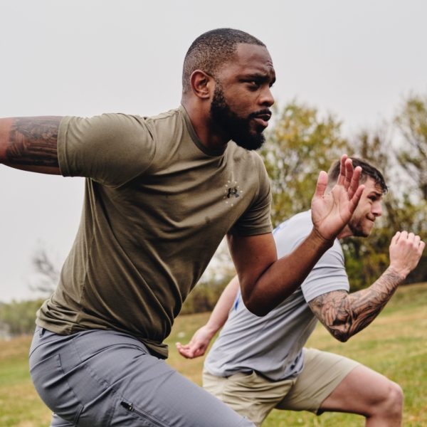 Two men exercising outdoors in Under Armour clothes