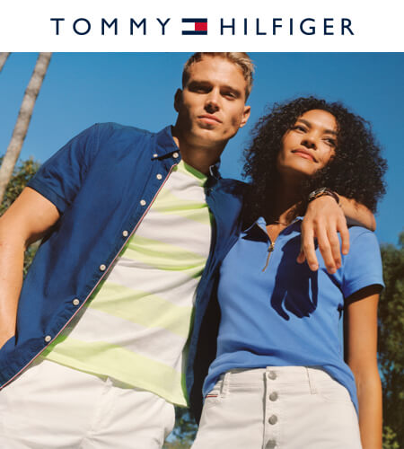Young man and woman wearing summer Tommy Hilfiger clothing