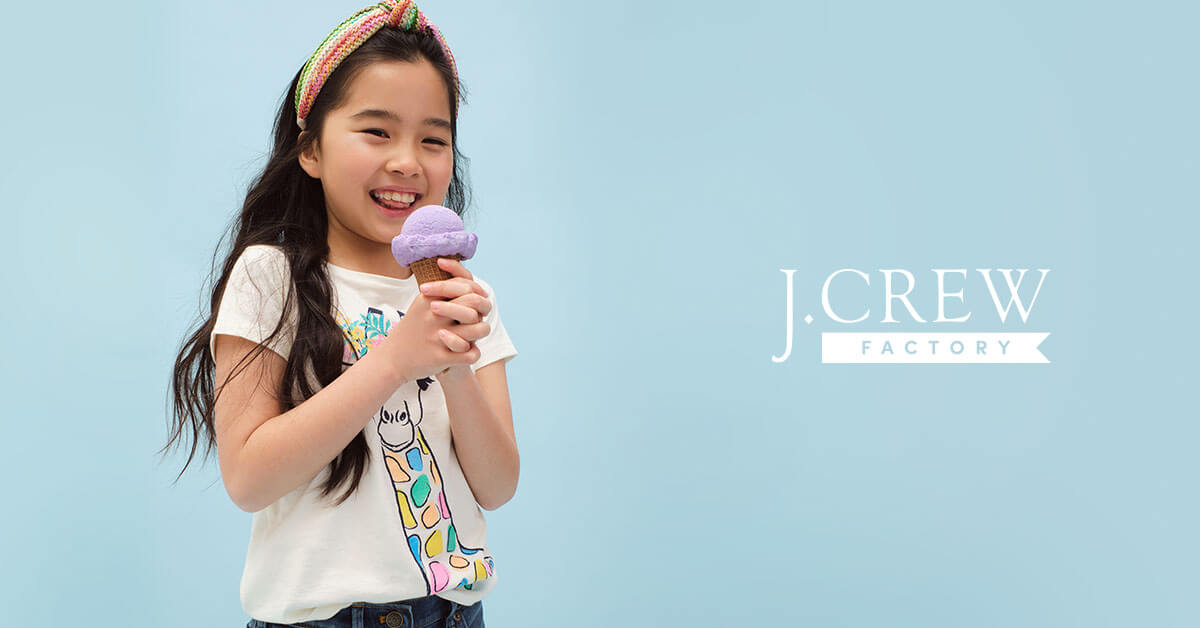 Young girl wearing J. Crew clothing eating an ice cream cone