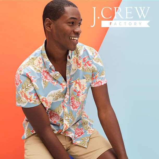 Model wearing a J. Crew floral t-shirt and tan shorts
