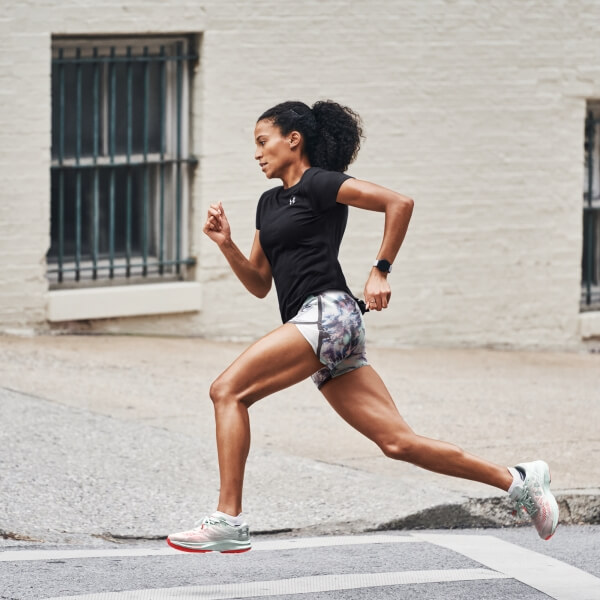 Young woman running wearing Under Armour clothing