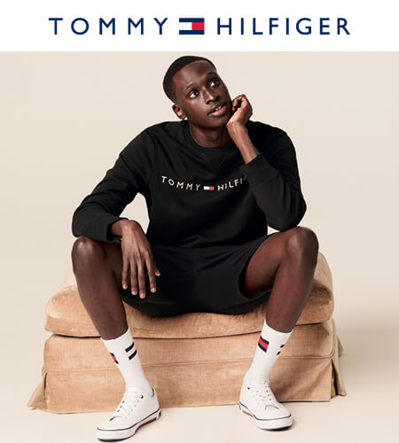Young man wearing casual Tommy Hilfiger apparel