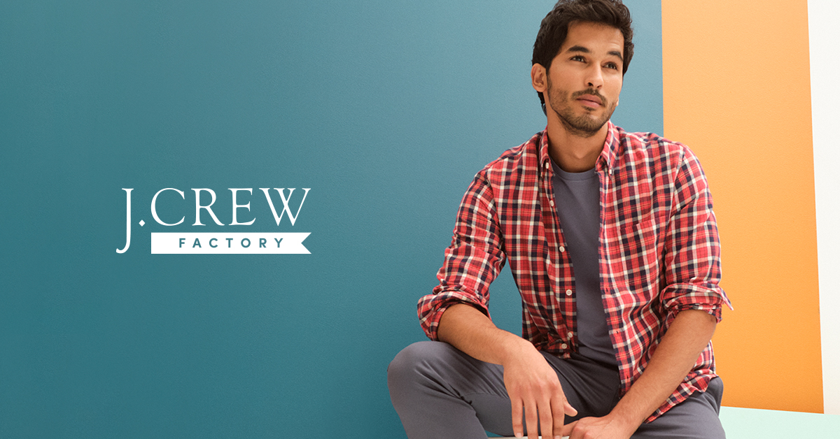 male model with brown hair wearing plaid jcrew shirt and grey tshirt and pants