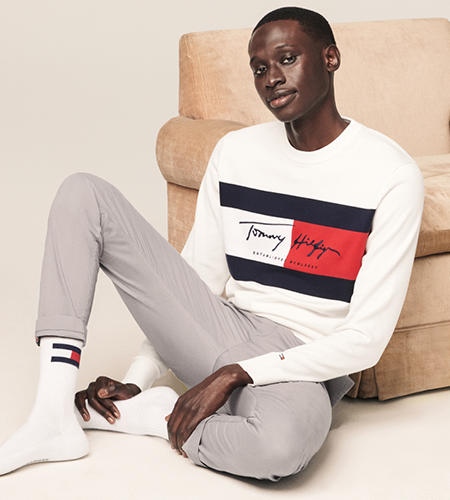Model wearing a white Tommy Hilfiger shirt