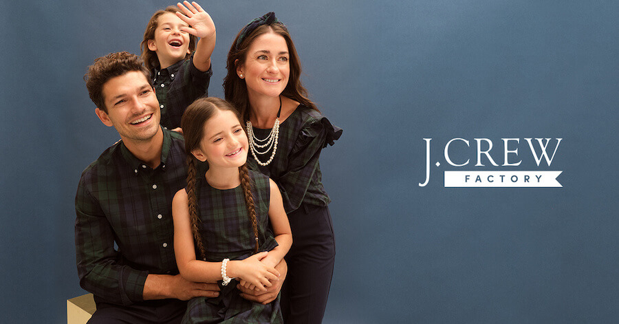 Smiling family wearing J. Crew apparel