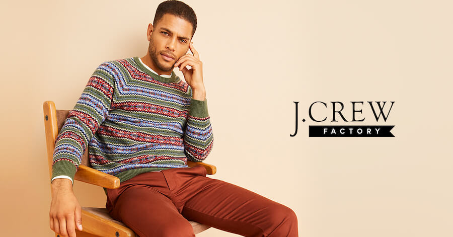 Young man wearing J. Crew sweater and pants