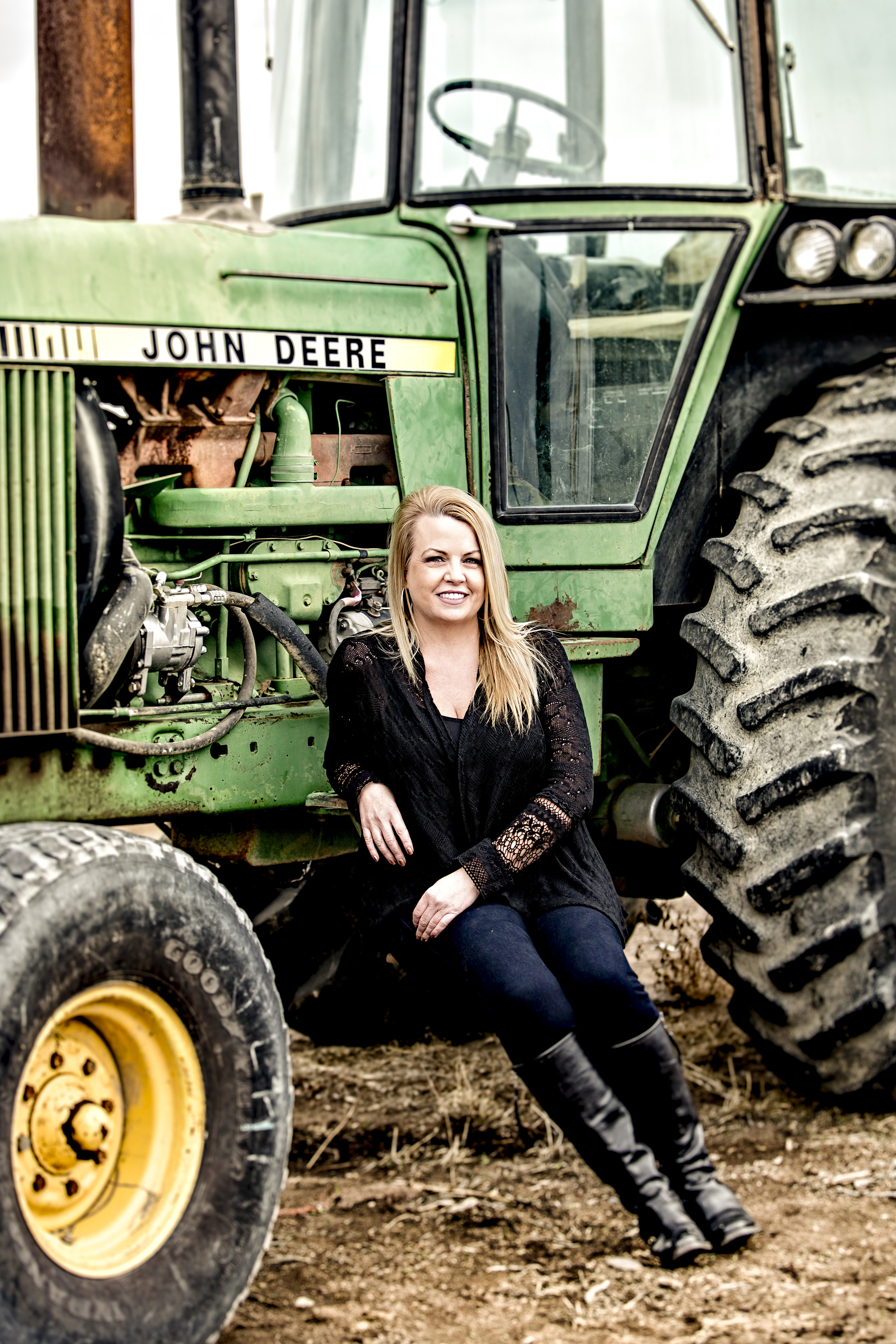 Photo of Tami Dunlap sitting on a tractor
