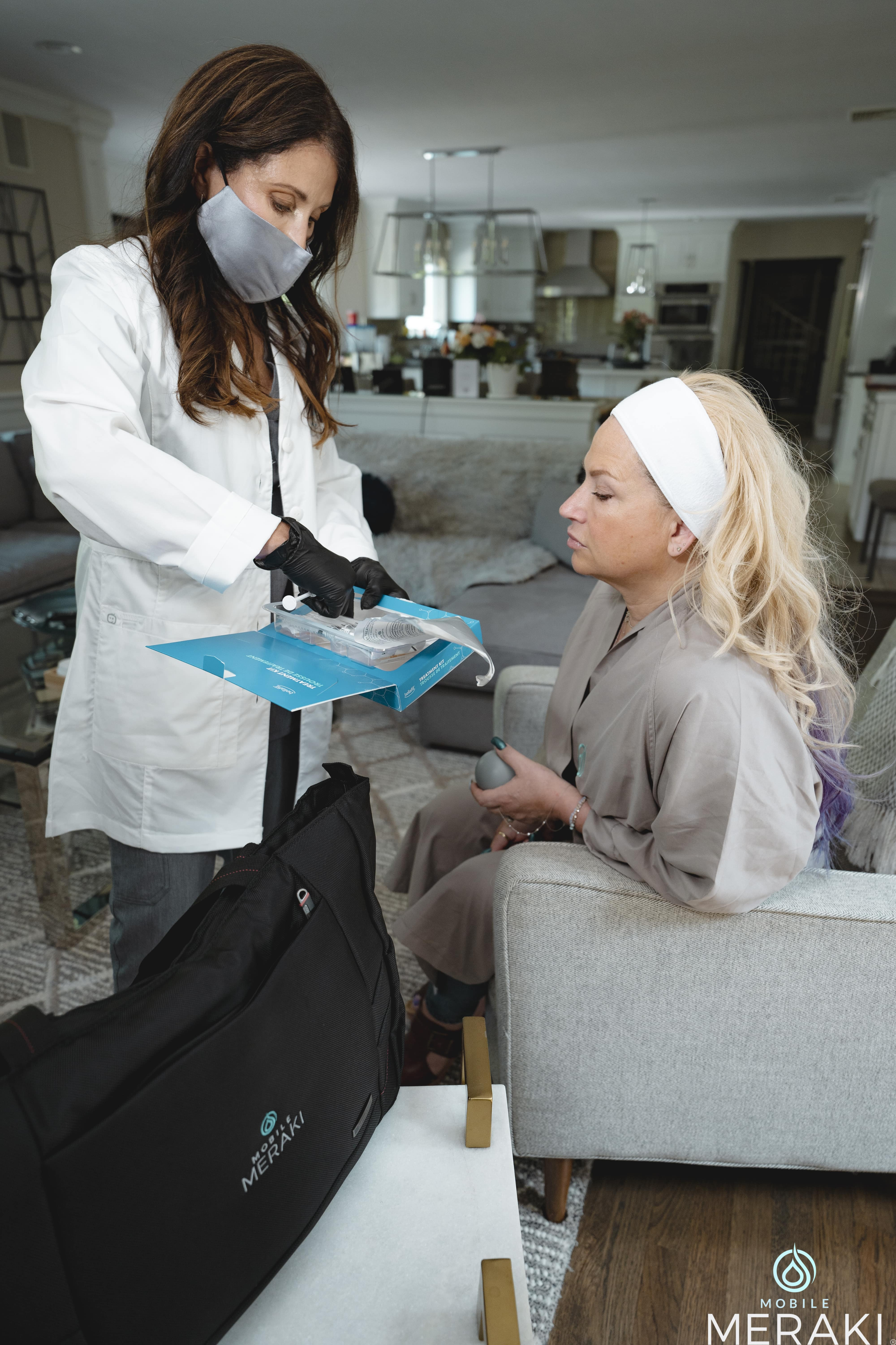 Meraki's In Home Care team helping a patient with options
