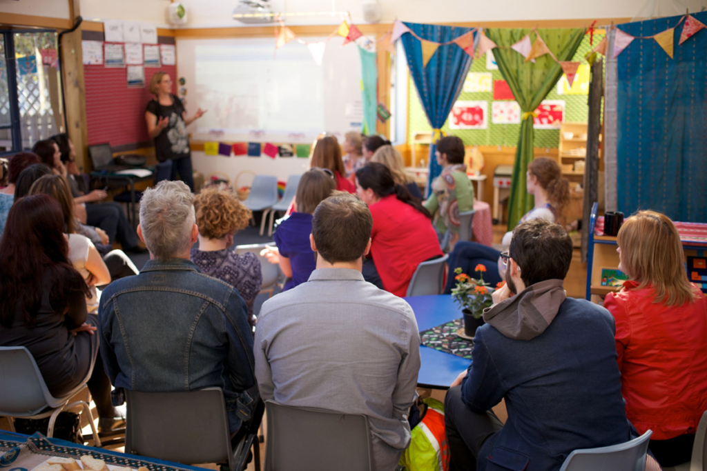 Group of adults having a meeting in a preschool