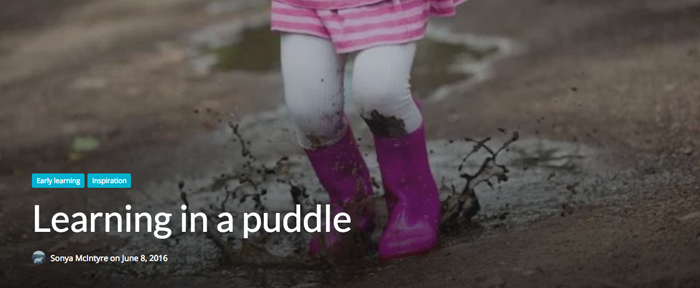 Toddler jumping over a mud puddle