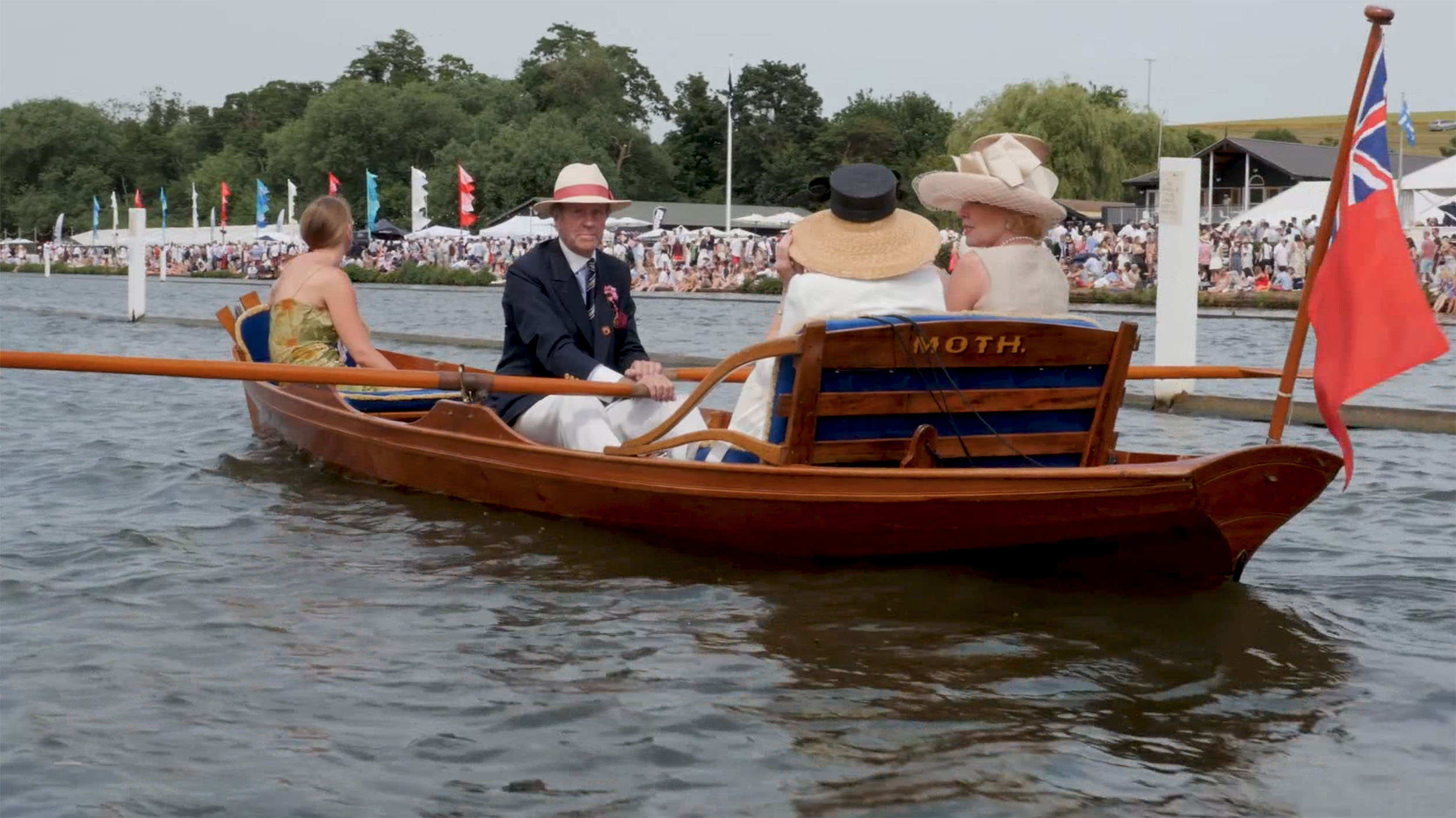 Henley Town Council - Man piloting boat down Henley river